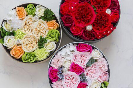 a bouquet in a round box