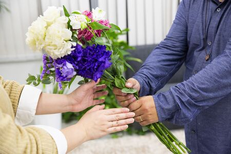 Husband sending flowers to wife Stock Photo