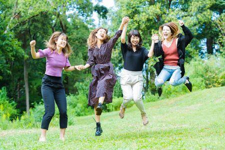 Women jumping 写真素材