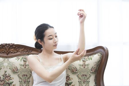 A woman who self-massages