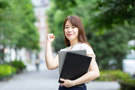 A woman cheering in a guts pose