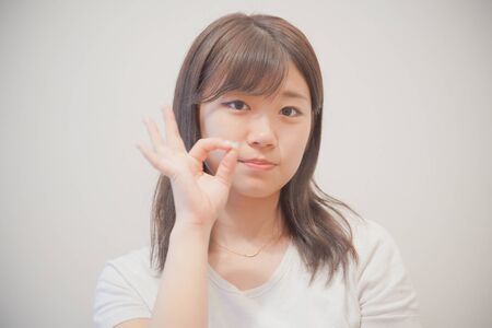 the OK sign woman 写真素材