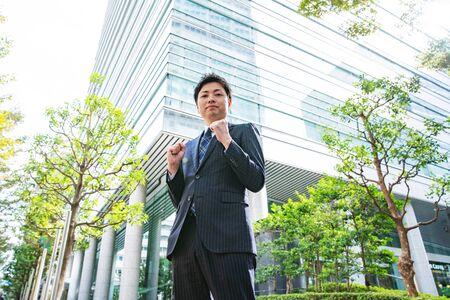 Guts Pose Businessman Stockfoto