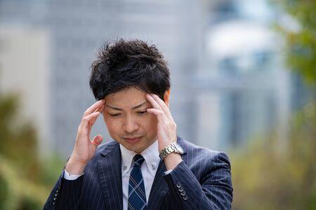 Businessmen suffering from headaches