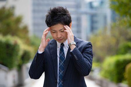 Businessman suffering from headaches