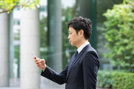 Businessmen using smartphones 写真素材