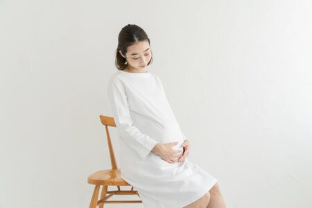 pregnant woman touching her tummy Stock Photo