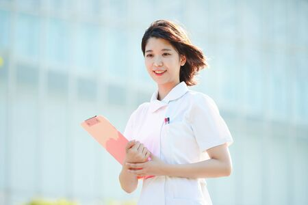 a woman in a white coat 写真素材
