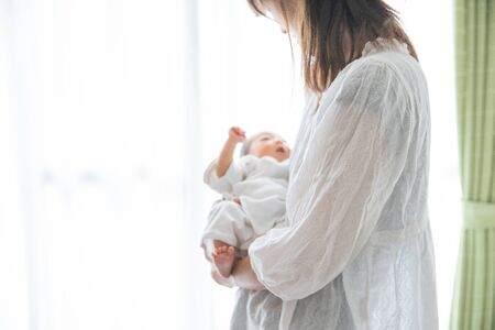 Newborn (0 years months) and mother