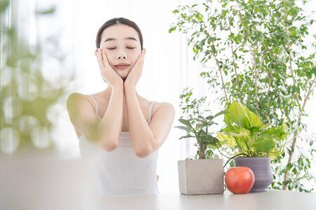 A woman doing self-massage Stock Photo