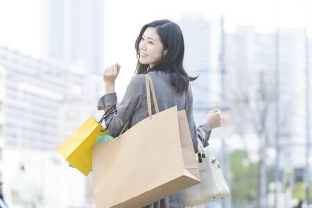 a woman with a lot of shopping bags