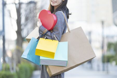 a woman with a lot of shopping bags 写真素材