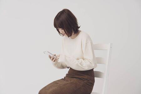 Woman using smartphone 写真素材