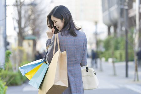 a woman who regrets shopping too much