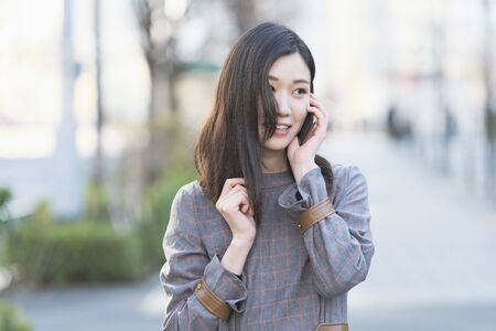 A woman who calls with a smile