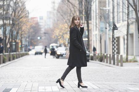 Walking through the business district of Tokyo, Japan