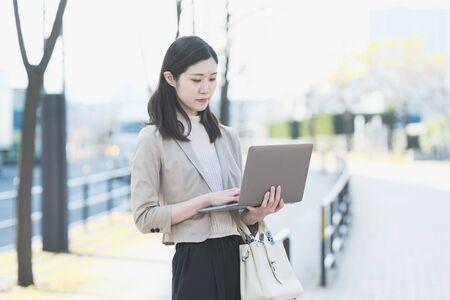 Businesswoman touching a laptop