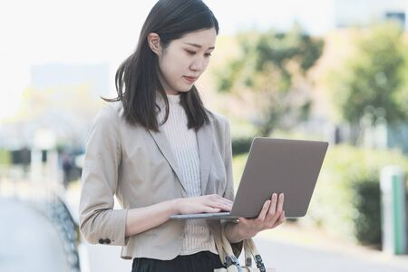 Businesswoman touching a laptop