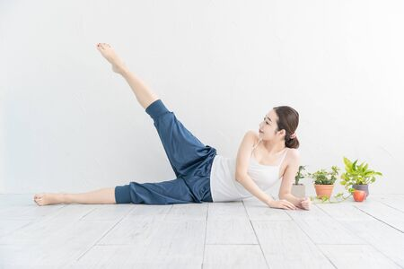 A woman doing stretching and gymnastics