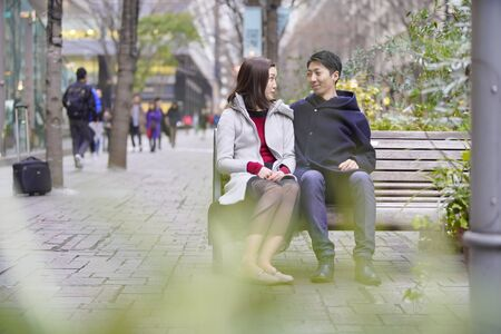 couple sitting and chatting