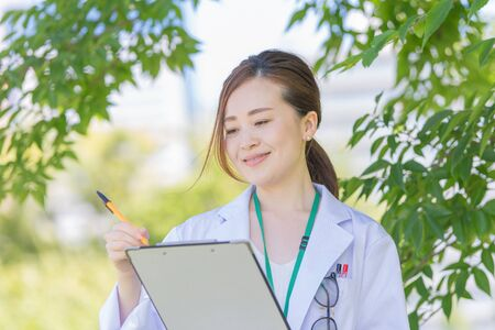 a woman in white who notes on her medical record