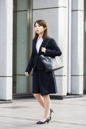 Woman in recruit suit