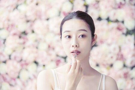 Makeup (lipstick), women's, flower background