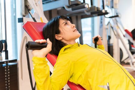 A woman exercising in the gym