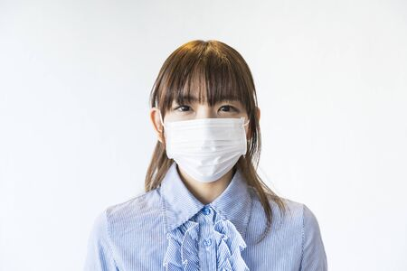 Asian woman wearing mask from nose to chin to prevent droplet infection Stock Photo
