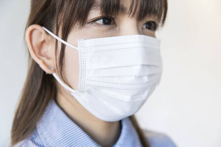 Asian woman wearing mask from nose to chin to prevent droplet infection