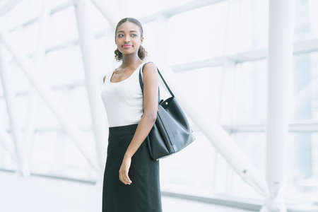 Portrait of an attractive young business woman with a smiling face