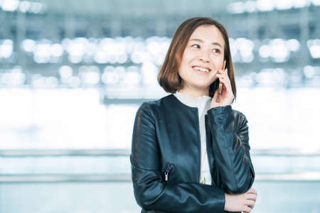 Asian business woman calling with a smartphone