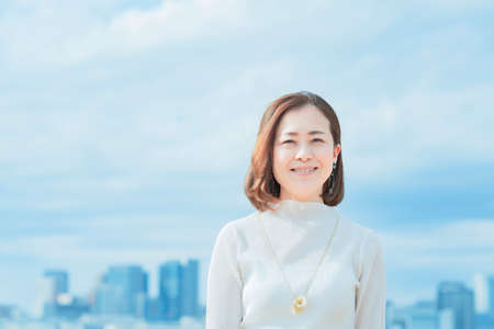 asian woman with office casual style smiling in tokyo city