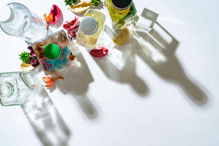 Colorful herbarium bottles and shadows on white board