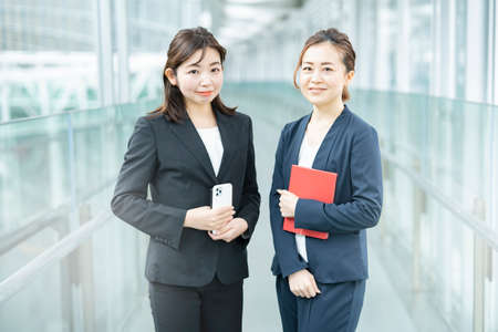 Business women looking at the camera in business district
