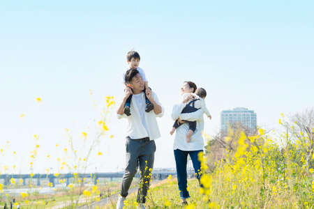 Asian parents and children taking a walk with a smile