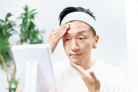 Asian middle men doing skin care in the room