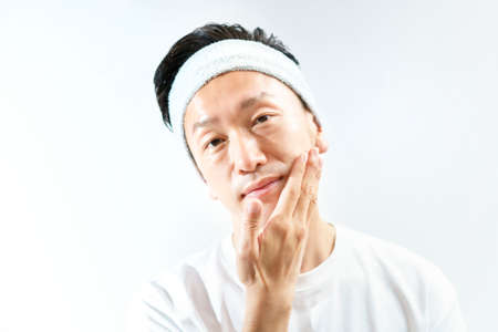 Middle-aged man touching his face Stockfoto