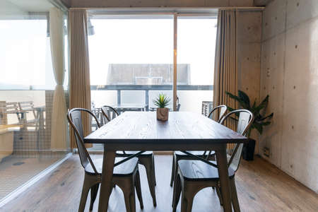 A wood table and chairs placed by the window in the living room