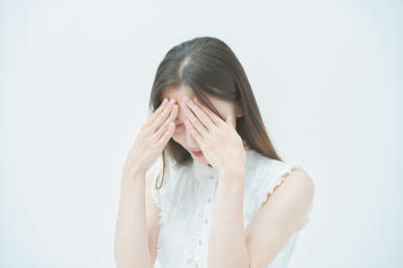 Asian young woman with a stressed look