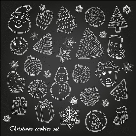 Big set of Christmas cookies sketch on chalk-board