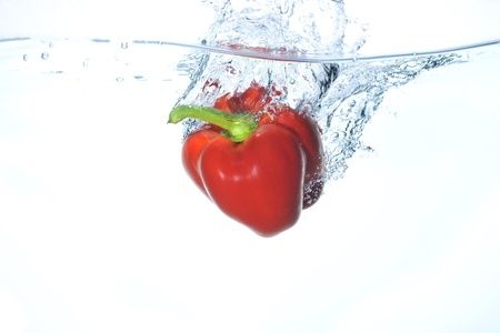 The paprika which jumps into water Stock Photo