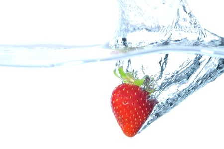 strawberry splash: The paprika which jumps into water Stock Photo