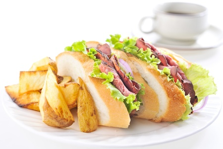 Sandwich of the roast beef and coffee photo