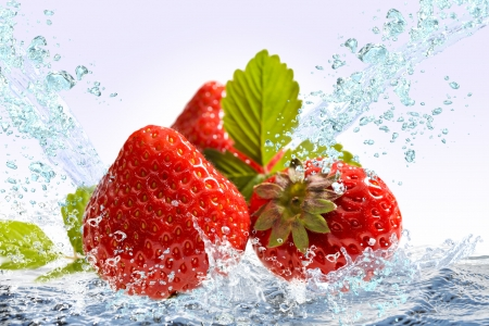 Strawberry splash Wed Stock Photo