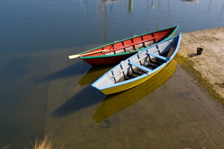 Two colorful wooden boats in docking - Binic harbor