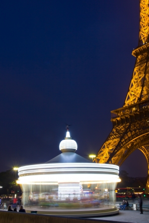 Paris, France - April 29, 2011: Eiffel Tower and his carousel in motion