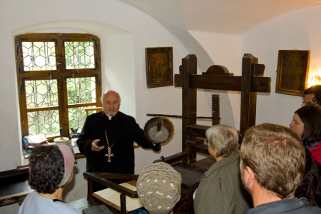 Professor, priest and guide, Vasile Oltean presenting the ancient writing tools of the Coresi master in the First Romanian School Museum, Brasov, Transylvania, Romania  Stock Photo - 14653925