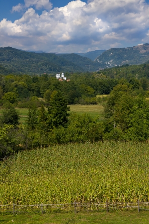 Romanian hill landscape with white church Stock Photo - 15807775
