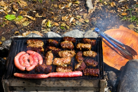 Preparing romanian meat specialties on barbecue photo